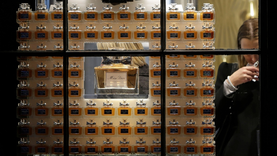 Customers sample Miss Dior perfumes inside a Dior store. (Matthew Lloyd/Bloomberg/Getty Images)