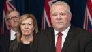 Ontario Premier Doug Ford answers questions as Minister of Health Christine Elliott and Ontario Chief Medical Officer of Health Dr. David Williams, left, listen in during a news conference at the Ontario Legislature in Toronto on Monday March 16, 2020. THE CANADIAN PRESS/Frank Gunn