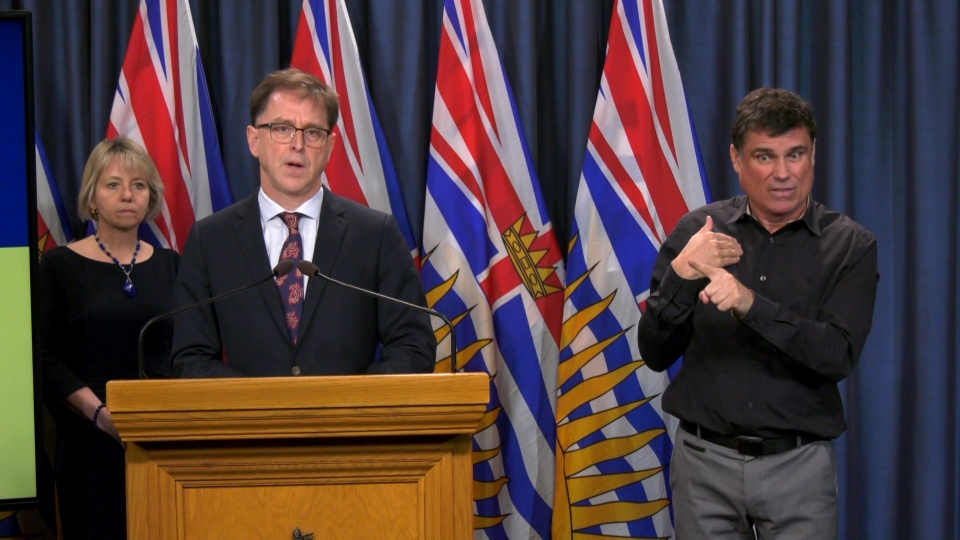 B.C. Health Minister Adrian Dix, centre, speaks to reporters about the province's response to COVID-19 on Monday, March 16, 2020.