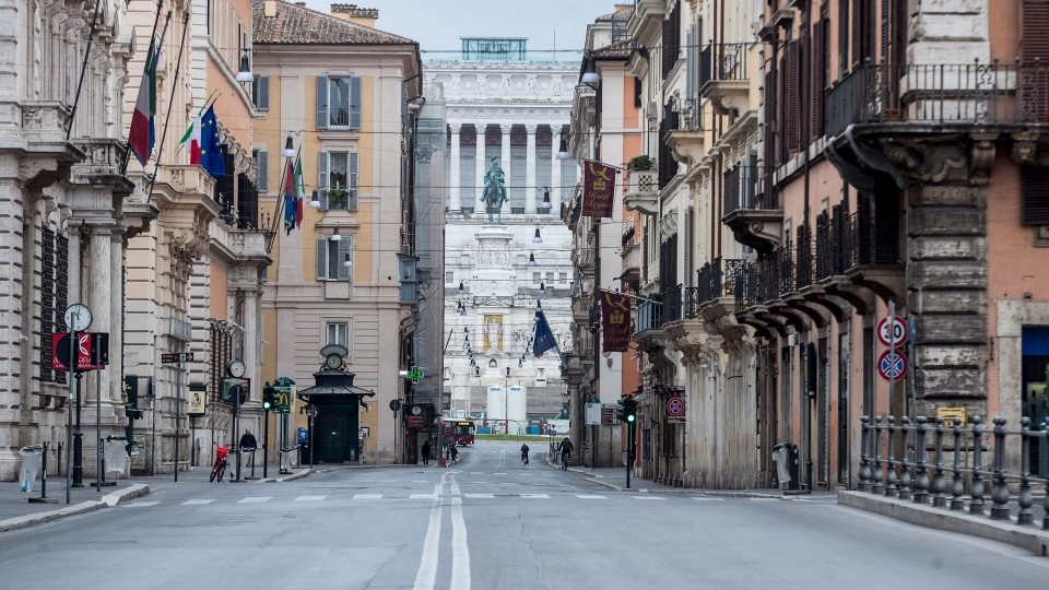 One of the main shopping streets in the center, which goes from Piazza del Popolo to Piazza Venezia, in background, is completely deserted in Rome, Saturday, March 14, 2020. (Roberto Monaldo/LaPresse via AP)