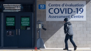 A man makes his way to a COVID-19 assessment centre setup at a city building Saturday, March 14, 2020 in Ottawa. (Adrian Wyld/THE CANADIAN PRESS)