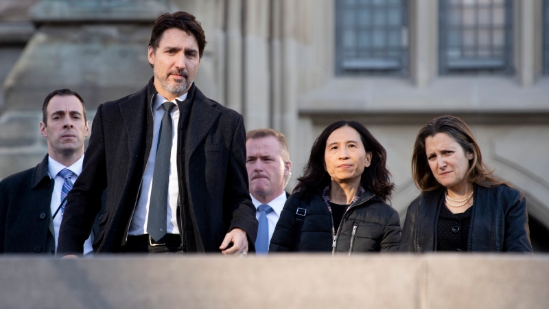 Prime Minister Justin Trudeau walks with Chief Medical Officer Theresa Tam and Deputy Prime Minister and Minister of Intergovernmental Affairs Chrystia Freeland to a news conference on the coronavirus situation, in Ottawa, Wednesday, March 11, 2020. THE CANADIAN PRESS/Adrian Wyld