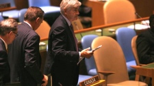 Foreign Affairs Minister Lawrence Cannon and members of the Canadian delegation leave as Iran's President Mahmoud Ahmadinejad is introduced at United Nations headquarters, Wednesday, Sept. 23, 2009. (AP / Jason DeCrow)