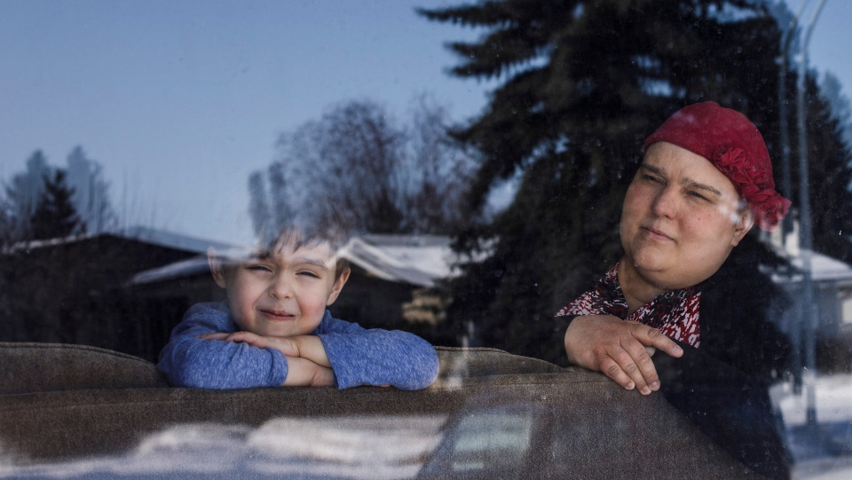 Meghan Villeneuve, a mother of two with breast cancer, is seen with her son Alyre Villeneuve in Edmonton on Monday March 16, 2020. THE CANADIAN PRESS/Jason Franson