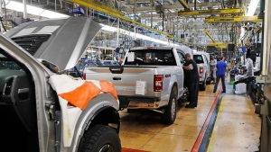 FILE - In this Sept. 27, 2018, file photo a United Auto Workers assemblymen work on a 2018 Ford F-150 trucks being assembled at the Ford Rouge assembly plant in Dearborn, Mich. (AP Photo/Carlos Osorio, File)