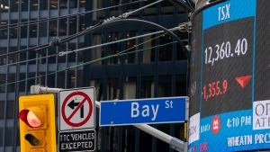 A sign board in Toronto displays the TSX close on Monday March 16, 2020. THE CANADIAN PRESS/Frank Gunn