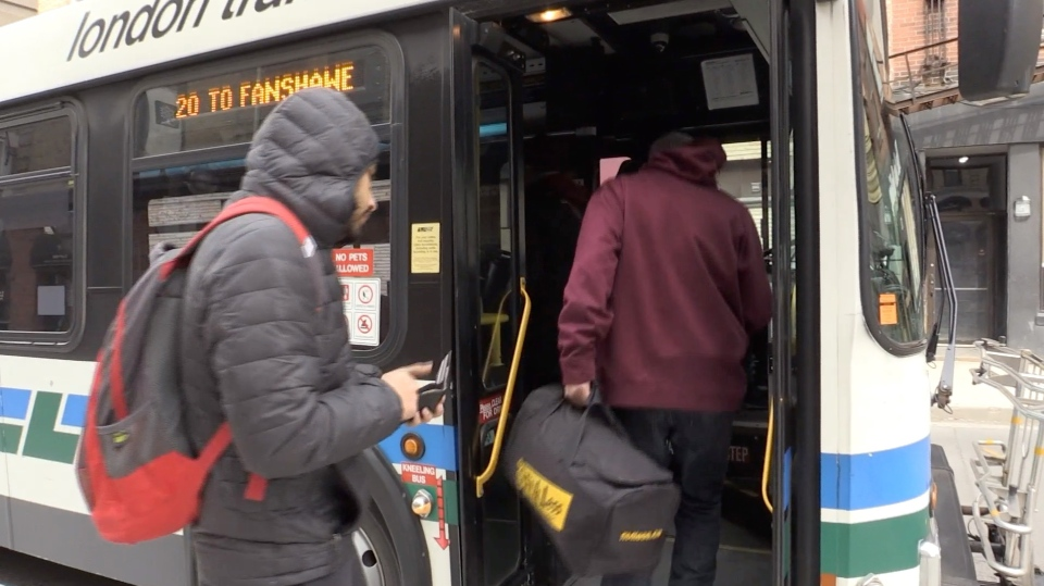 Passengers board a London Transit Commission bus in London, Ont. on Wednesday, March 18, 2020. (Marek Sutherland / CTV London)