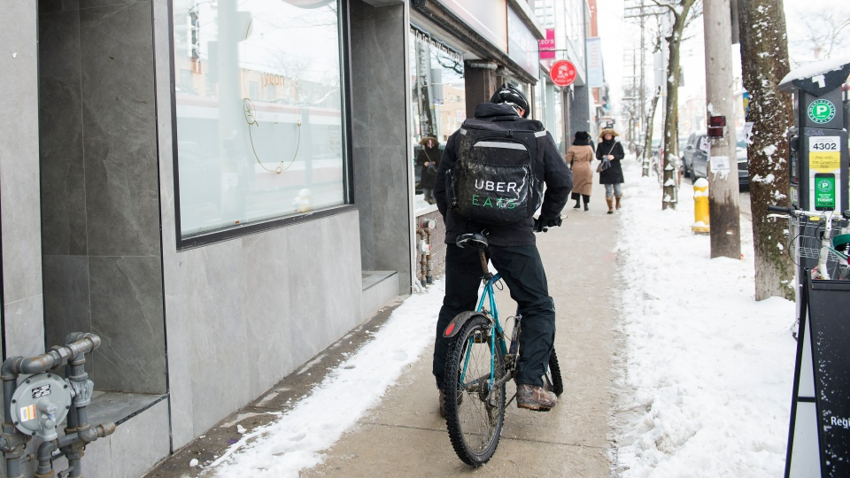 An Uber Eats courier is pictured as they pick up an order for delivery from a restaurant in Toronto, Thursday, Feb. 27, 2020. THE CANADIAN PRESS/Nathan Denette