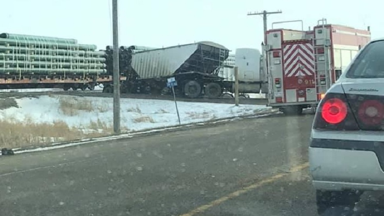 Train strikes semi-trailer