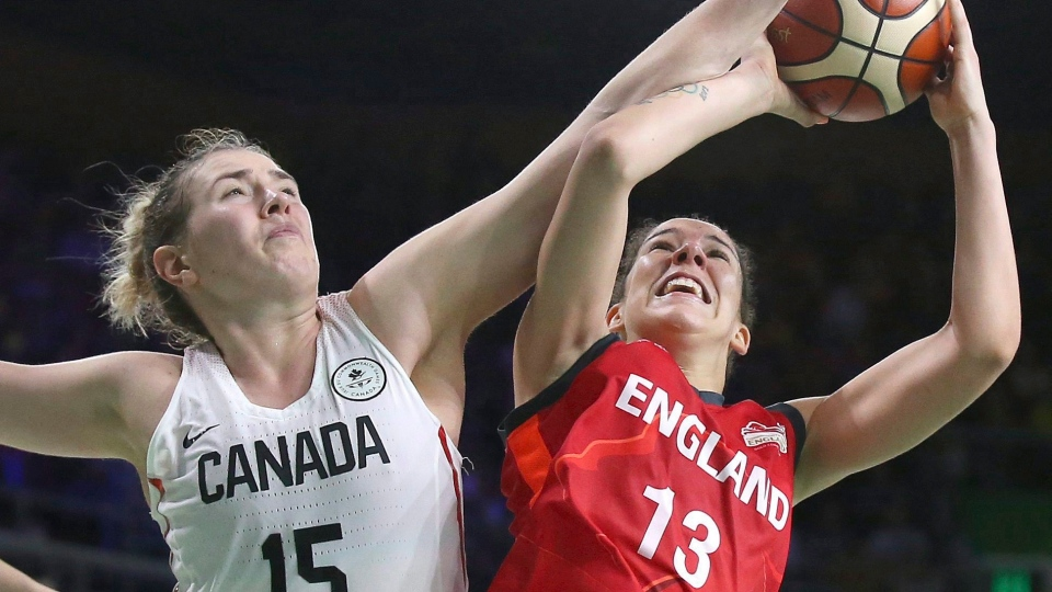 England's Azania Stewart, right, is fouled by Canada's Ruth Hamblin during their women's semifinal basketball game at the Convention Centre during the 2018 Commonwealth Games on the Gold Coast, Australia, Friday, April 13, 2018. THE CANADIAN PRESS/AP-Rick Rycroft