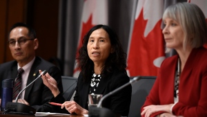 Chief Public Health Officer of Canada Dr. Theresa Tam speaks as Minister of Health Patty Hadju, right, and Deputy Chief Public Health Officer Dr. Howard Njoo listen during a press conference on COVID-19 in West Block on Parliament Hill in Ottawa, on Thursday, March 19, 2020. THE CANADIAN PRESS/Justin Tang