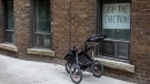 A sign hangs in the window of a west Toronto apartment on Thursday March 19, 2020. THE CANADIAN PRESS/Chris Young