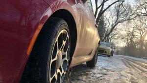A March 20, 2020 photo shows cars parked along a street in a Saskatoon neighbourhood.