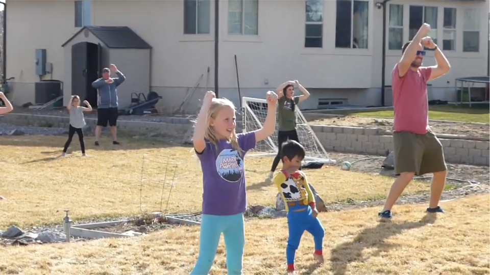 Kids and adults participate in the outdoor class