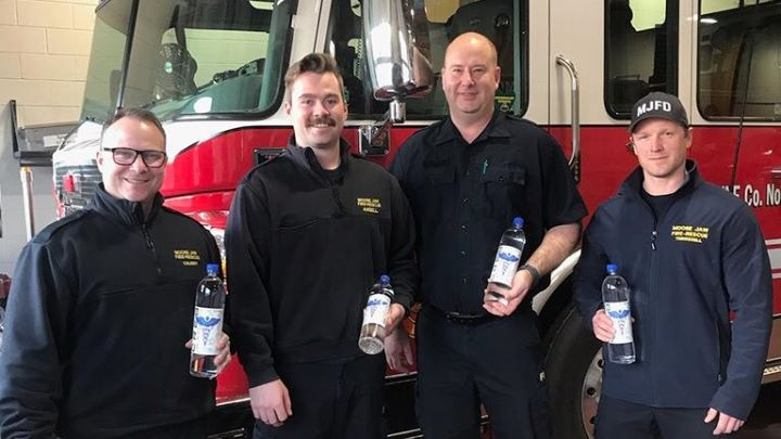 The Moose Jaw Fire Department receives Emergency Vodka 70 per cent from Smooth 42 Craft Distillery (Facebook: Smooth 42 Craft Distillery)