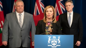 Ontario Minister of Health Christine Elliott answers questions as Minister of Finance Rod Phillips, right, and Premier Doug Ford listen in at Queen's Park in Toronto on Wednesday March 18, 2020. THE CANADIAN PRESS/Frank Gunn