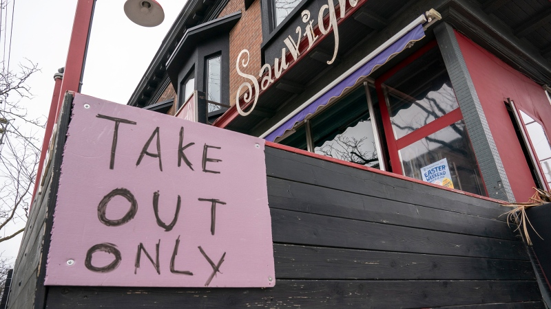 "A restaurant in Toronto displays a ""Take Out Only"" sign on Wednesday, March 18, 2020. THE CANADIAN PRESS/Frank Gunn"