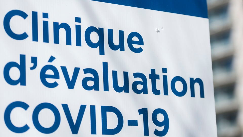 A sign for a COVID-19 evaluation clinic is shown in Montreal, Saturday, March 21, 2020, as COVID-19 cases rise in Canada and around the world.THE CANADIAN PRESS/Graham Hughes