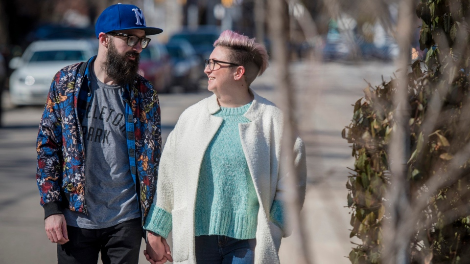 Steph Davidson and her partner Will Kemp walk around their neighbourhood in Toronto on Saturday, March 21, 2020. Davidson and Kemp may have just met on Christmas Eve, but in