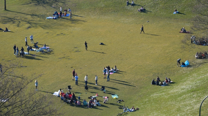 Crowds gather at English Bay in Vancouver on Saturday, March 21, 2020 despite the provincial health officer's warning to stay two metres apart from others to prevent the spread of COVID-19. (CTV)