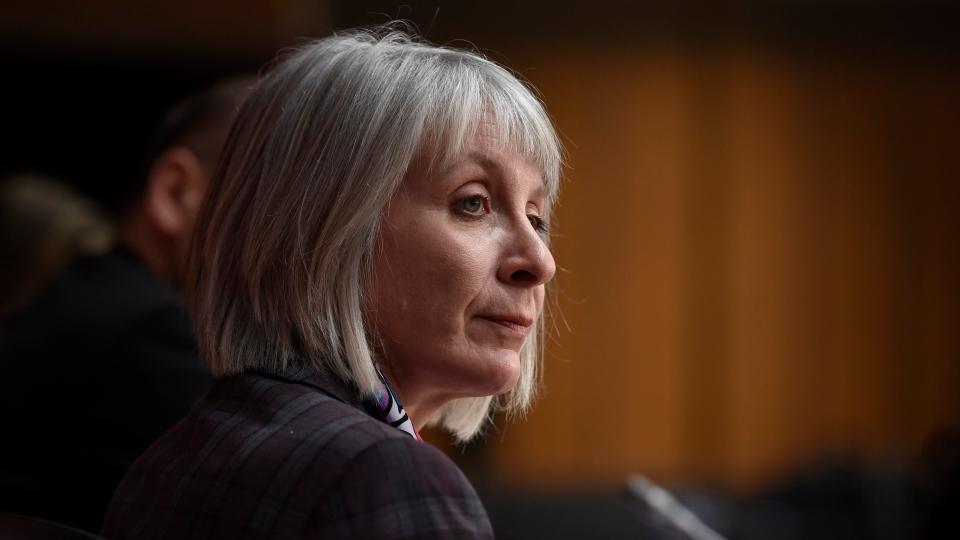 Minister of Health Patty Hajdu listens during a press conference on COVID-19 in West Block on Parliament Hill in Ottawa, on Friday, March 20, 2020. (THE CANADIAN PRESS / Justin Tang)