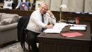 Ontario Premier Doug Ford works from his office in the Ontario Legislature in Toronto, on Saturday, March 21, 2020. (THE CANADIAN PRESS/Chris Young)