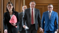 Quebec Premier Francois Legault, flanked by Quebec Health Minister Danielle McCann, left, and Horacio Arruda, right, Quebec director of National Public Health, walk to the daily news conference on the COVID-19 pandemic at the legislature in Quebec City. THE CANADIAN PRESS/Jacques Boissinot