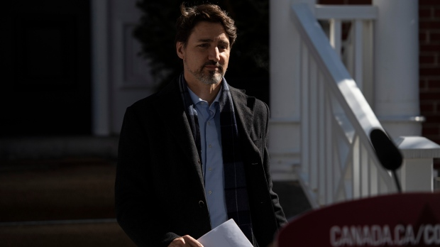 Prime Minister Justin Trudeau arrives for a press conference about COVID-19 in front of his residence at Rideau Cottage on the grounds of Rideau Hall in Ottawa, on Sunday, March 22, 2020. THE CANADIAN PRESS/Justin Tang
