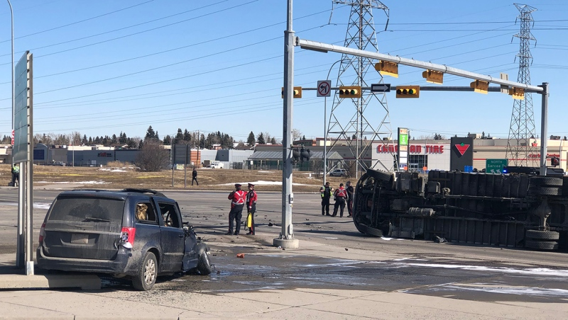 A damaged minivan and a toppled commercial truck at the intersection of Sarcee Tr. and Richmond Rd. S.W. Both drivers were injured in the crash.
