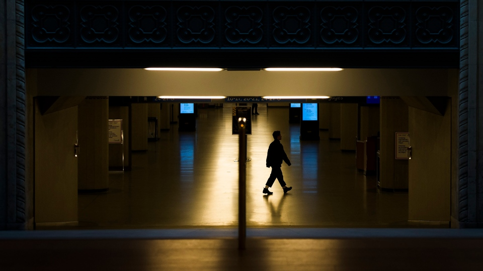 A lone person walks at Union Station in Toronto on Monday, March 23, 2020. (Nathan Denette/The Canadian Press)