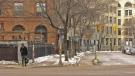 A lone pedestrian stands along Main street on Sunday, March 22, 2020. (Source: Dan Timmerman/ CTV News Winnipeg)