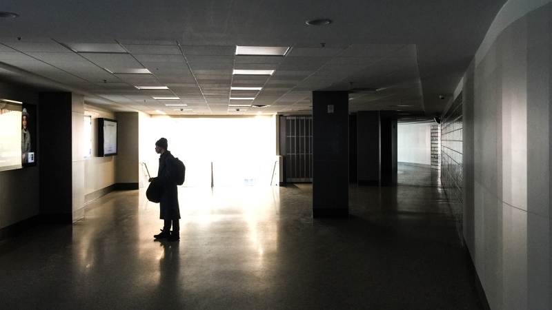 One pedestrian in the Downtown Winnipeg Skywalk meanders through the dark corridors on March 23, 2020. (Source: Danton Unger/ CTV News Winnipeg)