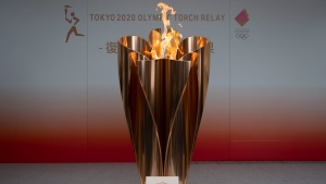 The Olympic flame is displayed during a public ceremony in Fukushima City, Japan, Tuesday, March 24, 2020. (AP Photo/Jae C. Hong)