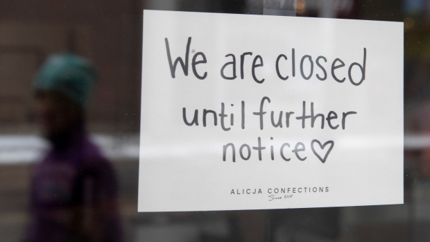 A sign on a shop window indicates the store is closed in Ottawa, Monday March 23, 2020. Ontario Premier Doug Ford announced non-essential businesses would be ordered closed. THE CANADIAN PRESS/Adrian Wyld