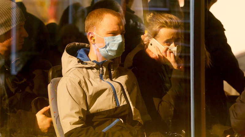 Passengers wear face masks on a bus in Kyiv, Ukraine, Thursday, March 18. 2020. (AP Photo/Efrem Lukatsky)