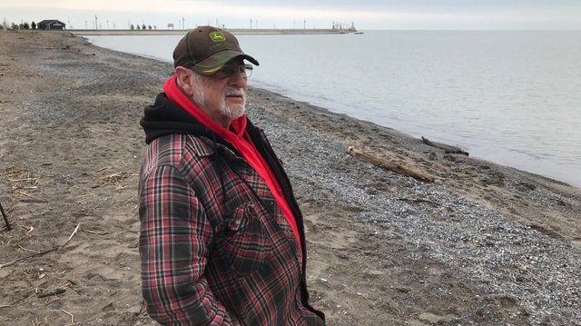 Bill Irvine, 74, looks to the water for solace amidst the COVID-19 crisis in Port Stanley, Ont. on Tuesday, March 24, 2020. (Sean Irvine / CTV London)