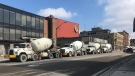 Cement trucks line up along York Street in London, Ont. on Tuesday, March 24, 2020. (Jim Knight / CTV London)