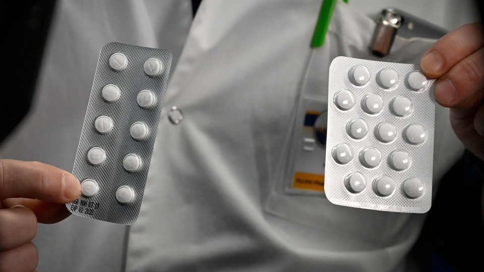 Medical staff shows packets of Nivaquine, tablets containing chloroquine and Plaqueril, on Feb. 26, 2020 at the IHU Mediterranee Infection Institute in Marseille. (Gerard Julien/AFP/Getty Images/CNN)
