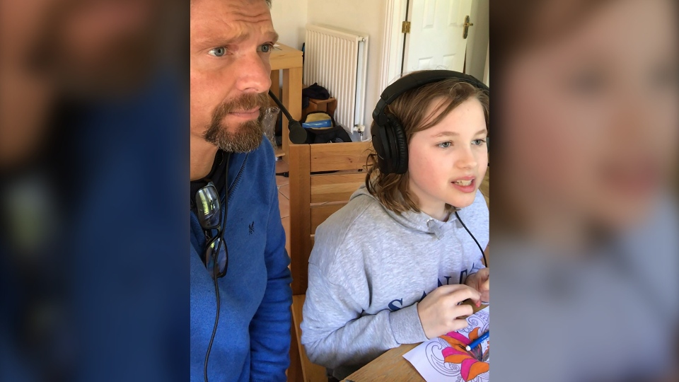Cricket announcer Mark Church takes a selfie photo with his daughter Isabelle, in Cardiff, Wales, Sunday March 22, 2020, while they record one of the video commentaries. (Mark Church via AP)