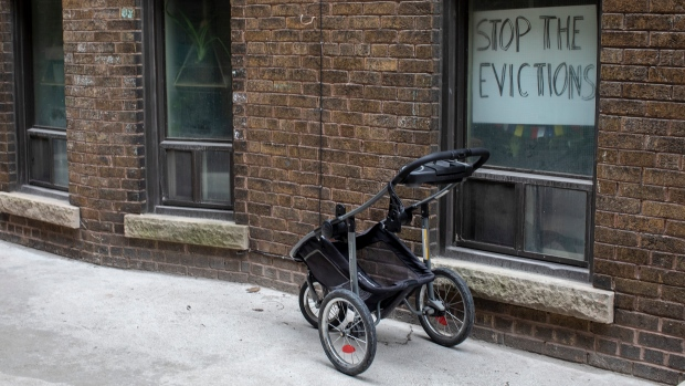 A sign hangs in the window of a west Toronto apartment on Thursday March 19, 2020. Tenants at 'Shoreview' on Toronto's King Street west say their landlord, Golden Equity Properties, has continued to issue eviction notices this week amid the COVID-19 pandemic and has shut off their water without warning on multiple occasions. THE CANADIAN PRESS/Chris Young