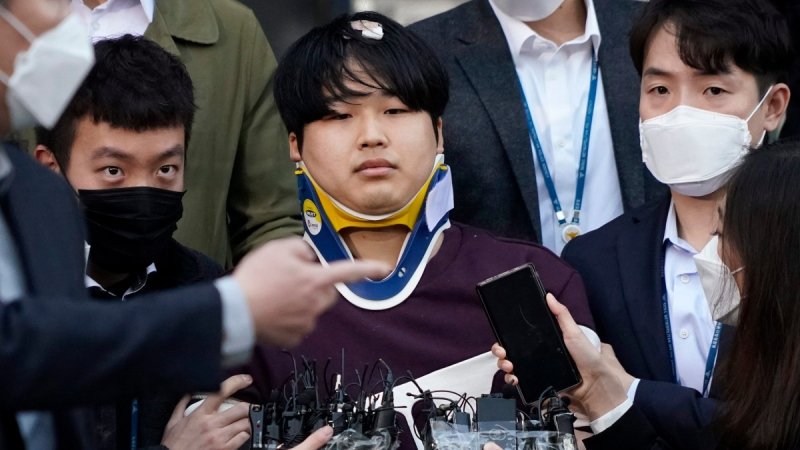 Cho Ju-bin walks out of a police station in Seoul, South Korea, on March 25, 2020. (Kim Hong-Ji / Pool Photo via AP)