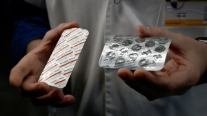 Medical staff at the IHU Mediterranee Infection Institute in Marseille, France show packets of chloroquine and hydroxychloroquine. (AFP)