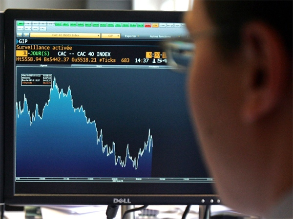 A broker works as his control screen shows a graph of activity on the French Stock Exchange in Paris on Friday, Aug. 10, 2007. (AP / Remy de la Mauviniere)