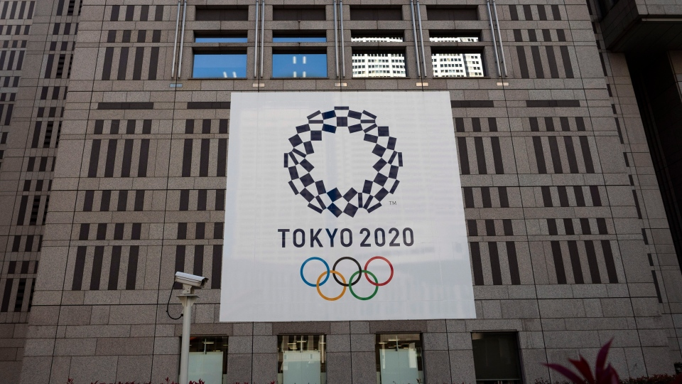 A banner promoting the Tokyo 2020 Olympics hands on the facade of the Tokyo Metropolitan Government building Wednesday, March 25, 2020, in Tokyo. (AP Photo/Jae C. Hong)