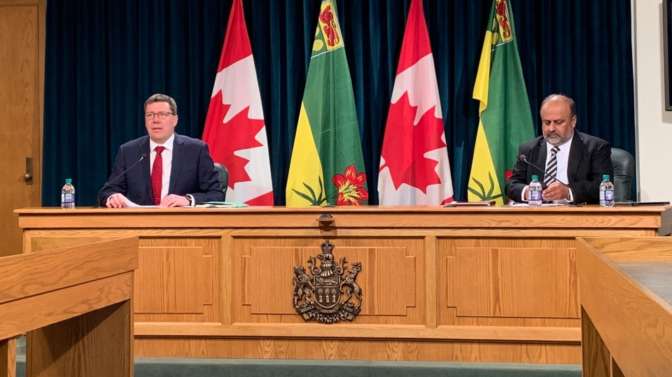 Premier Scott Moe and Chief Medical Health Officer Dr. Saqib Shahab speak at a press conference on March 25, 2020 (Marc Smith / CTV News Regina)