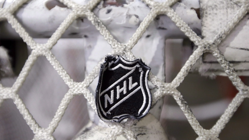 The NHL logo is seen on a goal at a Nashville Predators practice rink in Nashville, Tenn on Sept. 17, 2012. The league announced on Wednesday that it was temporarily halting its scouting combine, awards ceremony and draft that were scheduled for June amid the COVID-19 pandemic. It did not provide new dates for the events. THE CANADIAN PRESS/AP-Mark Humphrey