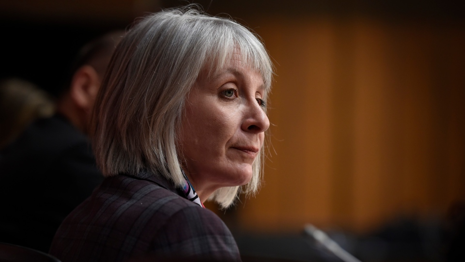 Minister of Health Patty Hajdu listens during a press conference on COVID-19 in West Block on Parliament Hill in Ottawa, on Friday, March 20, 2020. THE CANADIAN PRESS/Justin Tang