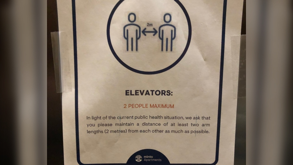 A Minto Apartments sign restricting elevators to two riders maximum during the COVID-19 pandemic.