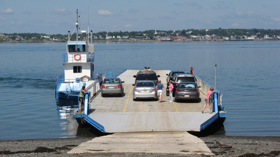 Passengers board a car ferry for the short trip from Campobello Island, N.B., to nearby Deer Island, N.B., on Aug 1, 2009.  (THE CANADIAN PRESS/Kevin Bissett)