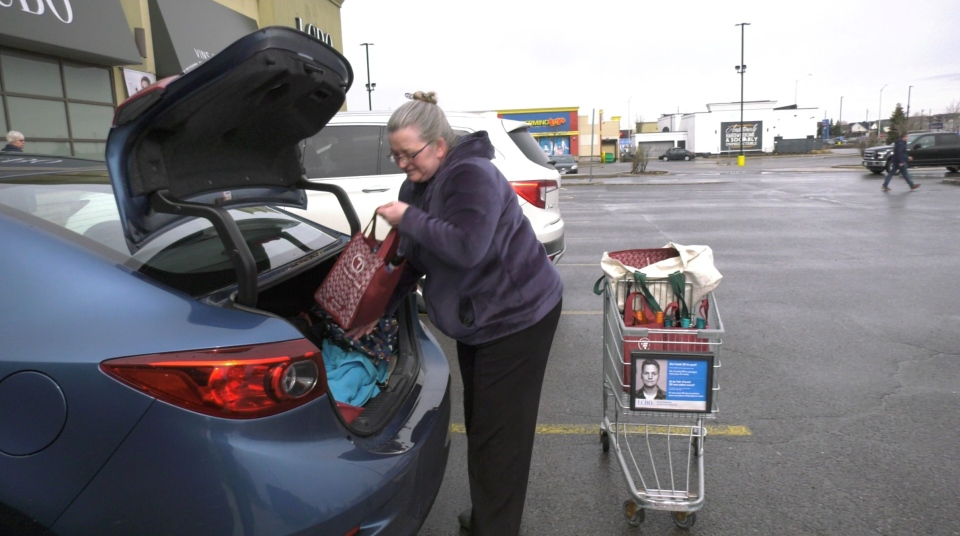LCBO customer loading wine into her car, delivering to seniors at risk. Ottawa, ON. March 26, 2020. (Tyler Fleming / CTV News Ottawa)